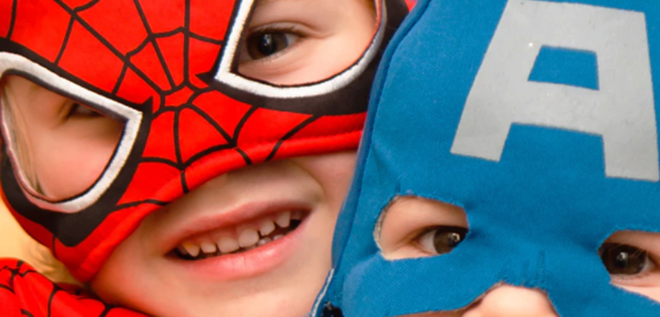 Two boys in a Super Hero costume
